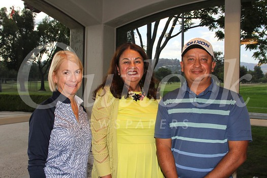 ChapCare CEO Margie Martinez is flanked by event co-chairs Dr. Terre Osterkamp and Juan Gallardo.