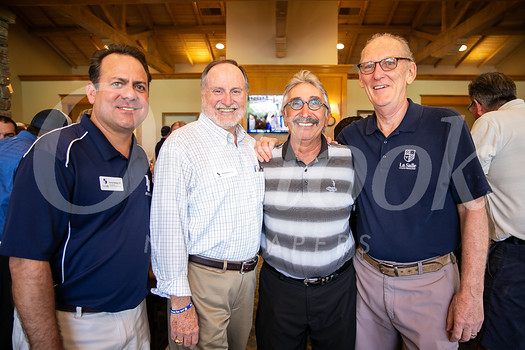 La Salle's Vice President of Development Kevin Delaney, interim President Patrick Bonacci, golf tournament honoree Harry Agajanian and Lancer Golf Classic volunteer coordinator Don Olender