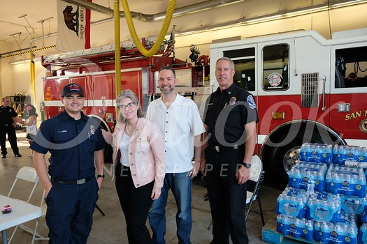Tim Chow, Rebecca and James Donvito, and Division Chief Eric Zanteson