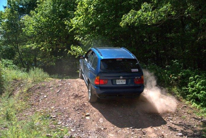 BMW X5 up dirt hill