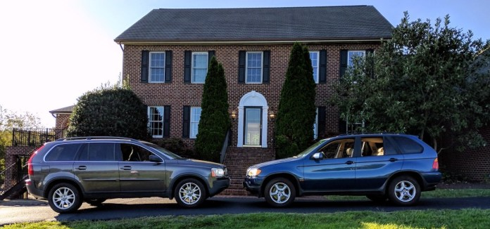 Volvo XC90 BMW X5 in front of house