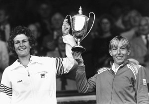 Women's Doubles tennis players Pam Shriver (left) and Martina Navratilova hold their trophy in the air after winning the Doubles at Wimbledon Tennis Championships, London, 1982. (Photo by Tommy Hindley/Professional Sport/Popperfoto/Getty Images)