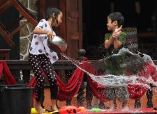 Kids throwing water in Pii Mai Lao