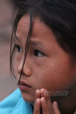 Young Lao girl at the alms giving ceremony