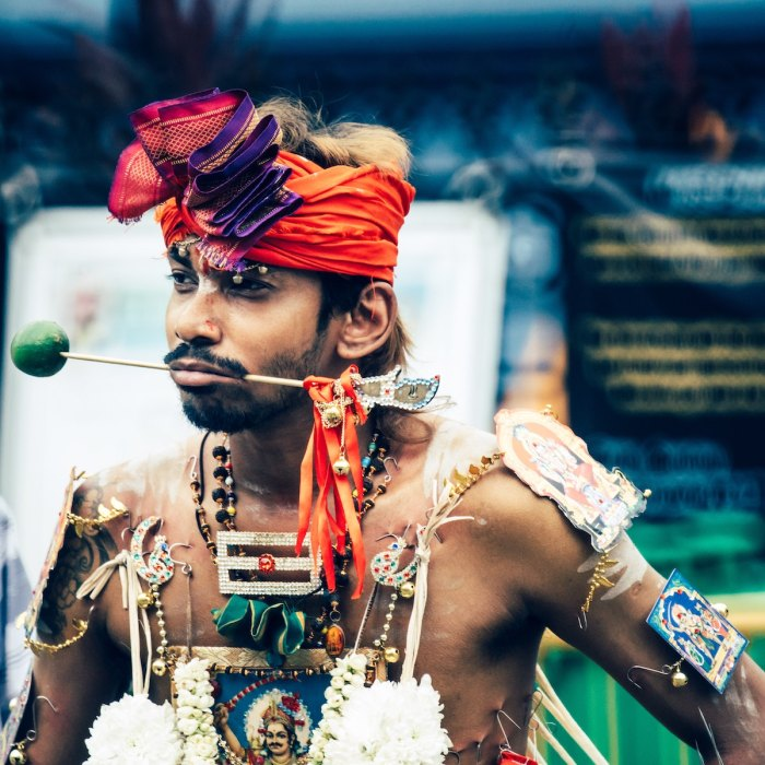 A photo captured during Thaipusam proceedings in Singapore photo by @dominik_photography via Unsplash