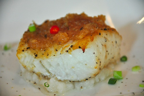 Roast Chilean Seabass with Chai Poh Confit on Light Congee