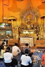 Buddhists offering prayer