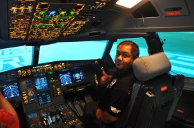 Melo Villareal inside Airbus A-320 Simulator at AirAsia Training Academy
