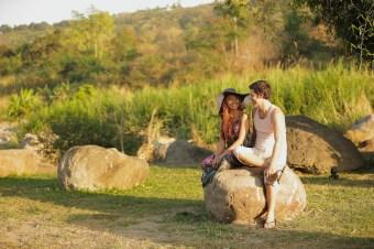 A couple enjoying the fresh air and the vibrant hues of green at Green Canyon
