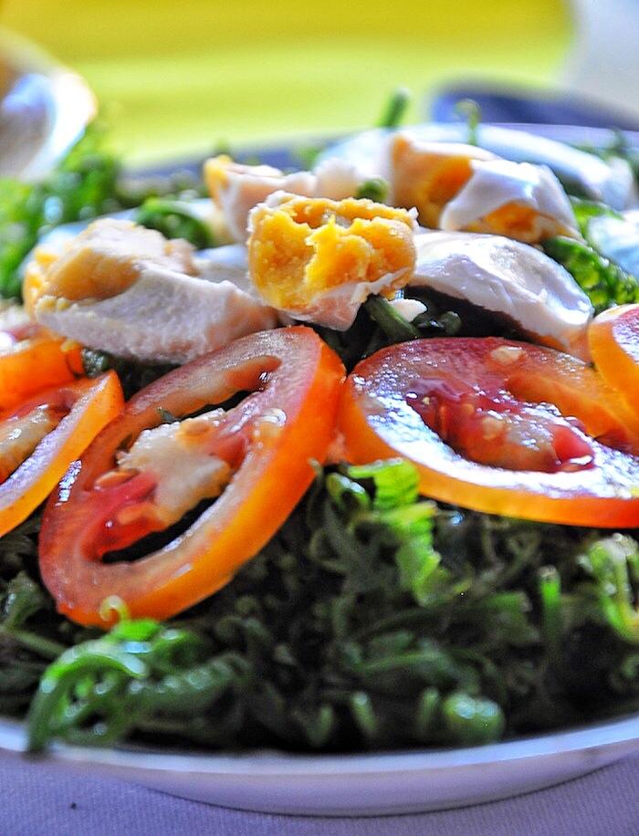 Fresh Pako Salad with tomatoes and salted egg