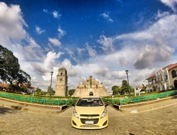 Chevrolet Spark in front of Paoay Church