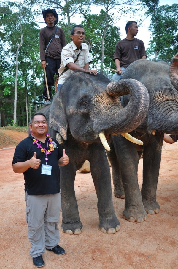 Melo Villareal with the youngest elephant in the village