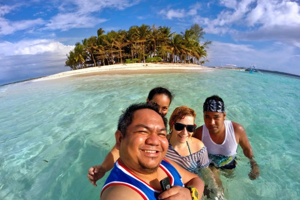 Sabrina Iovino with Filipino Travel Bloggers in Guyam Island Siargao