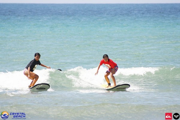 Surfing in Crystal Beach Zambales photo courtesy of Crystal Beach Resort FB