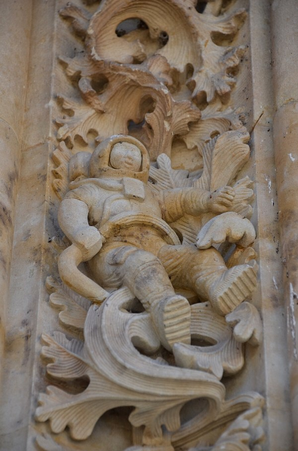 Salamanca Astronaut sits on the façade on the entrance to the New Cathedral, Salamanca, Spain