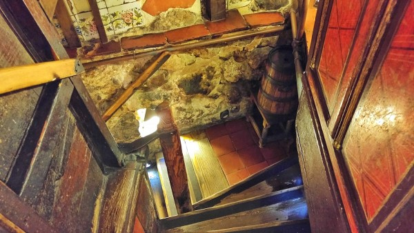 Steep staircases leading to the underground dining area