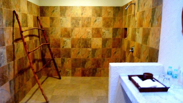 Shower area with bamboo clothes drying frame