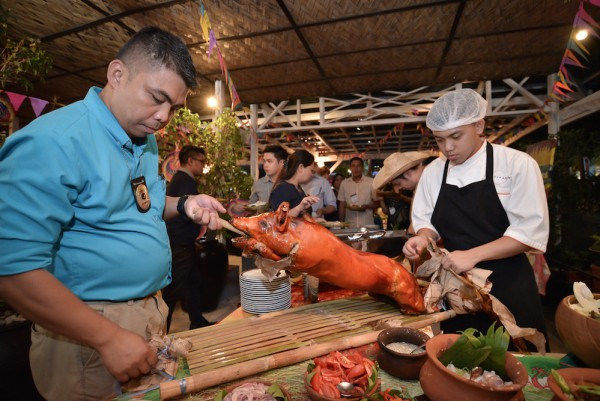 Philippine's National Dishes, the Lechon is being prepared for the Fiesta