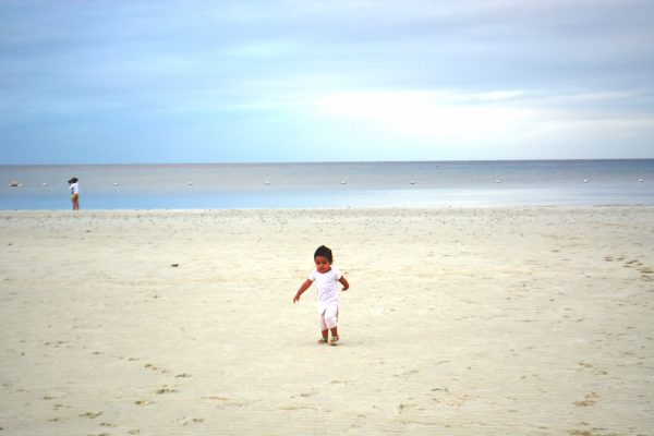The little one exploring the beach