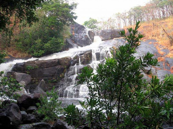 """Meenmutty Falls <em>Photo by </em><a href=""""https://commons.wikimedia.org/wiki/File:Meenmutty_Falls.jpg""""><em>Vssekm</em></a><em>, </em><a href=""""https://creativecommons.org/licenses/by-sa/3.0/deed.en""""><em>CC BY-SA 3.0</em></a>"""