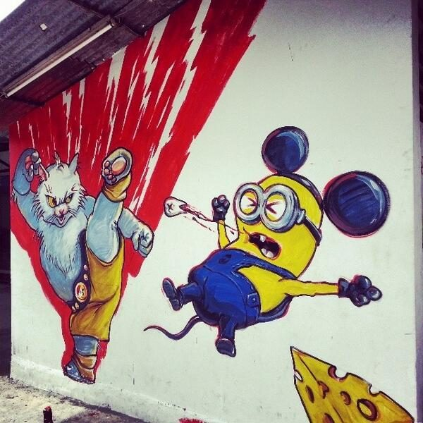 Cat Kicking Minion at Lebuh Victoria photo via Twitter
