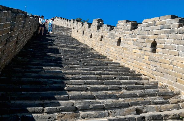 Visitors keen on climbing the steep steps in the Mutianyu wall
