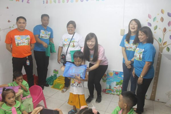 Hotel Jen Manila Executives take part in the school supply giving activity for Maytubig Day Care kids.