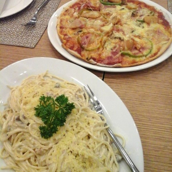 A satisfying Italian fare of Spaghetti a la Carbonara and a round of Meatlover's Pizza