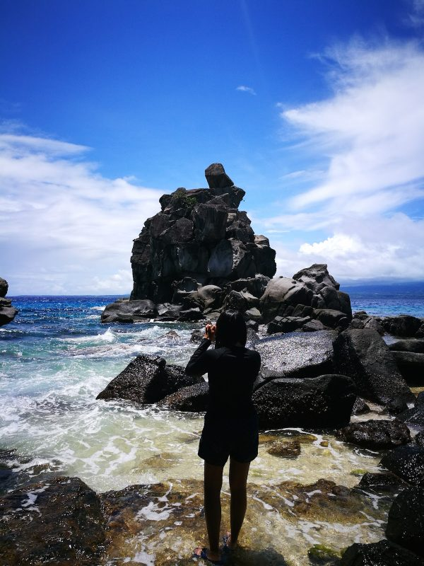 You can take a plunge into the deep waters from the top of that rock formation.