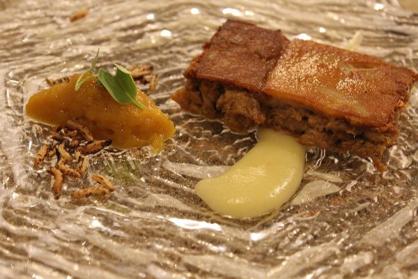 Suckling pig confit cube, mango chutney and inflated wild rice
