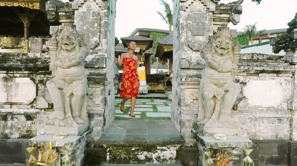 A small Balinese temple integrated into the design at the center of the resort, allowing guests a glimpse of local life.