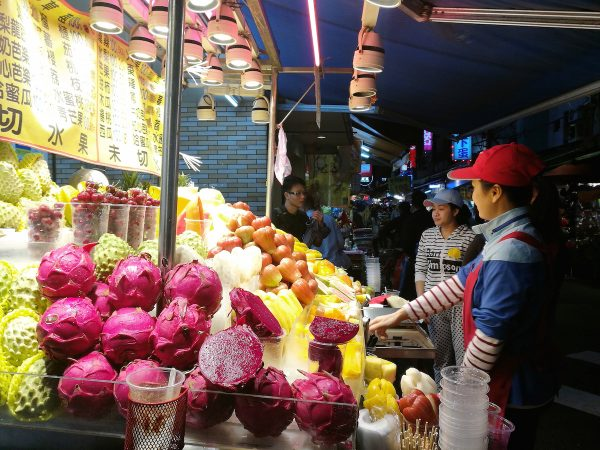Friendly Fruit Vendors at the Night Market in Taipei