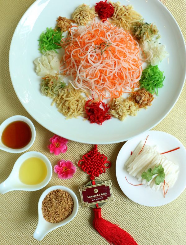 There are six varieties of Yee Sang at Shang Palace, from Korean snow pear to salmon and sliced abalone, among others