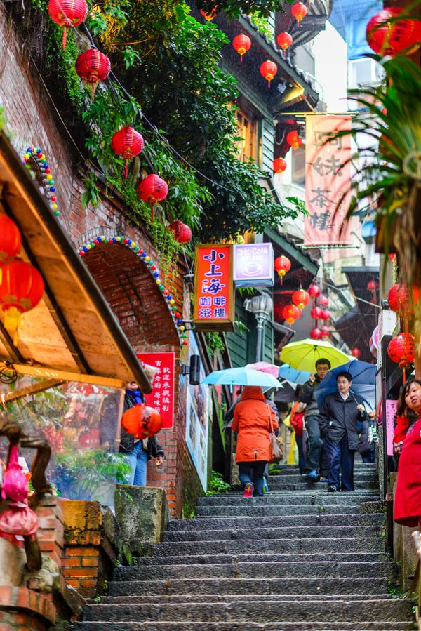 Tourists walk down famed steps in Jiufen