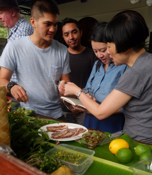 Farm owners Enzo Pinga of Earthbeat Farms (below) and Raphael Teraoka of Teraoka Farms show guests their fresh produce and farm-to-table ingredients