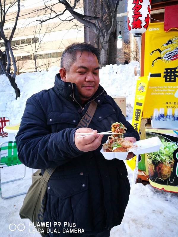 The author enjoying Takoyaki in Sapporo