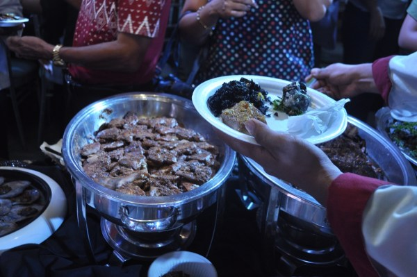 Various Moro-inspired like spiced curry beef paella negra valenciana line the kiosks during last year's Savores in Zamboanga City.