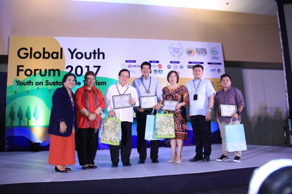 """Dr. Mina T. Gabor, ISST President (second from left) poses with Corazon Alma De Leon, ISST Senior Vice President for Domestic Affairs (leftmost); Senator Richard Gordon; Martin Diño, Subic Bay Metropolitan Authority (SBMA) Chairman; Undersecretary Alma Rita D. Jimenez and Assistant Secretary Daniel Angelo Ebarle Mercado from the Department of Tourism Regulation, Coordination, and Resource Generation; and Aiza Seguerra, National Youth Commission Chairperson and Chief Executive Officer."""""""