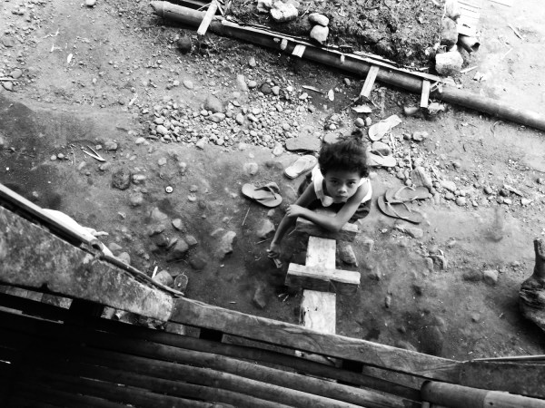 Blaan Kid playing at the wooden ladder
