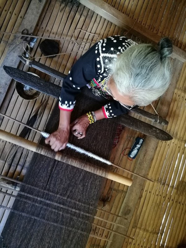 Blaan Women weaving abaca fiber tapestries called Tabih