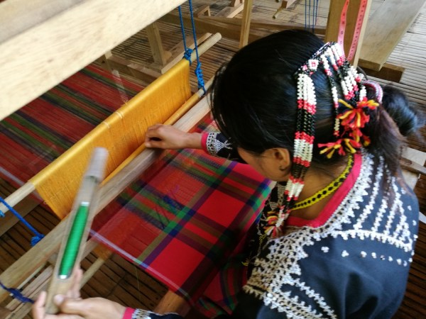 Blaan Women weaving traditional skirt