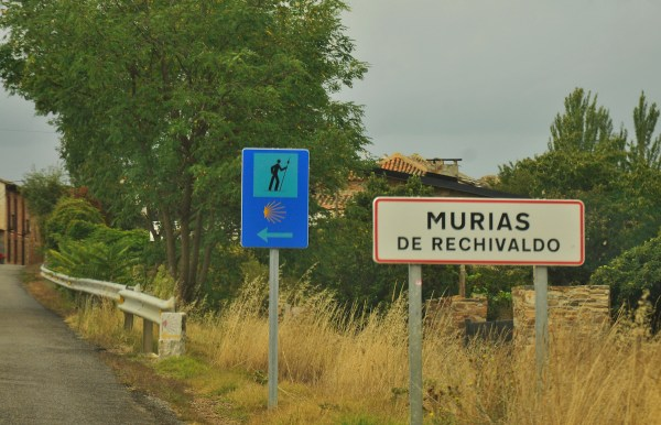 Signage pointing the way of the Camino at a small town after Astorga.