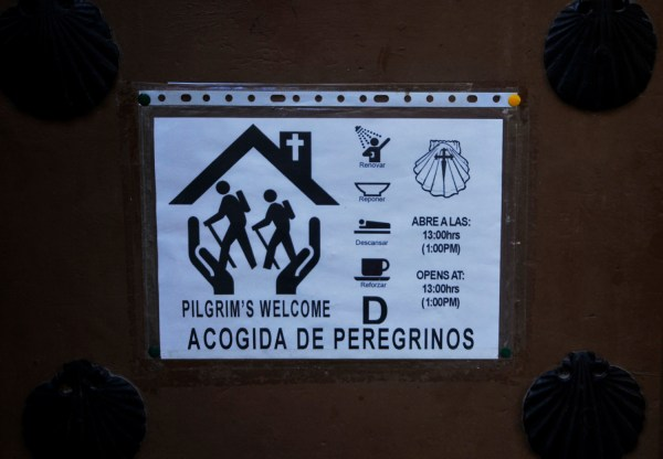 Typical notice on an entrance door of a pilgrims inn, the albergue.