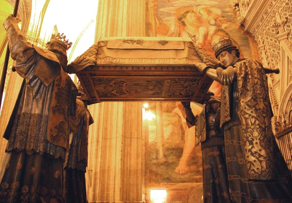 The tomb of Christopher Columbus on the shoulders of the Kings of Castile inside the Seville Cathedral.