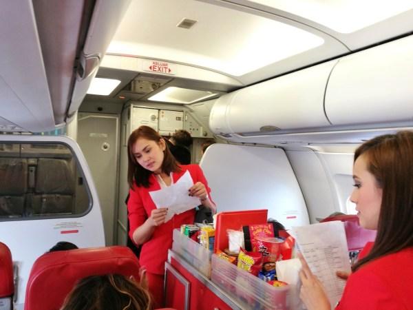 AirAsia Cabin Crews serving Santan Inflight Food
