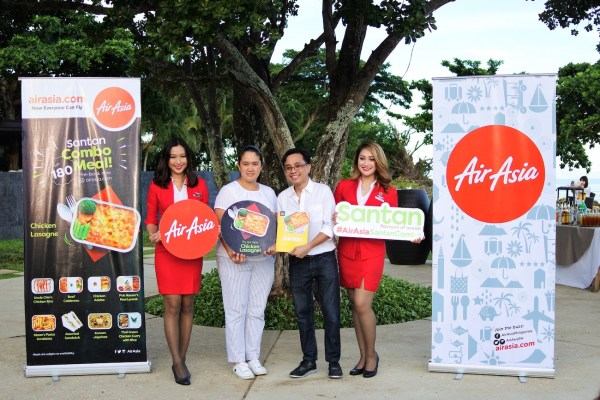 Cabin crew with Amorita Resort Bohol Marketing Director Kata Agmata and Philippines AirAsia Ancillary Head Karlo Serafin