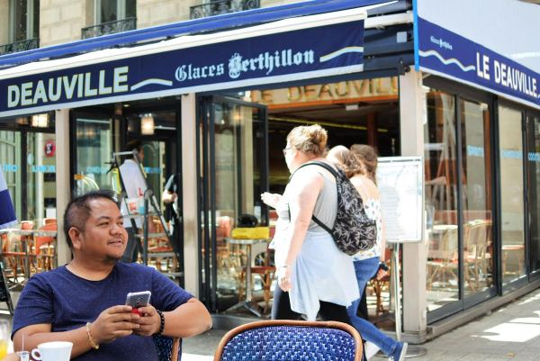 Enjoying a cup of Coffee in the streets of Paris