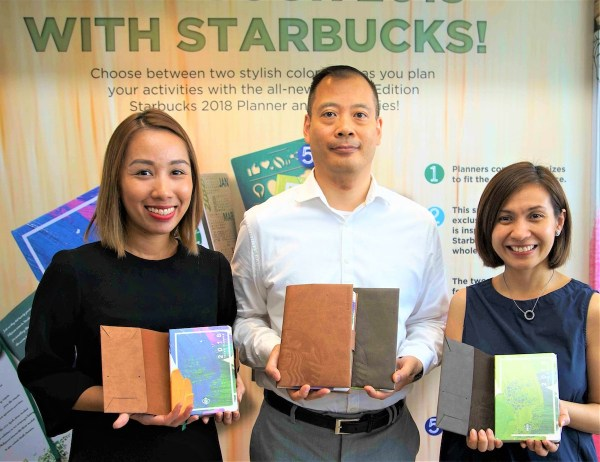 START THE CHRISTMAS CHEERS. Starbucks Philippines category manager Jamie Silva, head of marketing Keith Cole, and marketing manager Ira Rogado officially launch the Starbucks 2018 Planners.