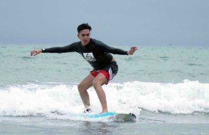 SURF'S UP. A Reef FTSM 2 participant riding the wave at Surfari Beginner's Competition