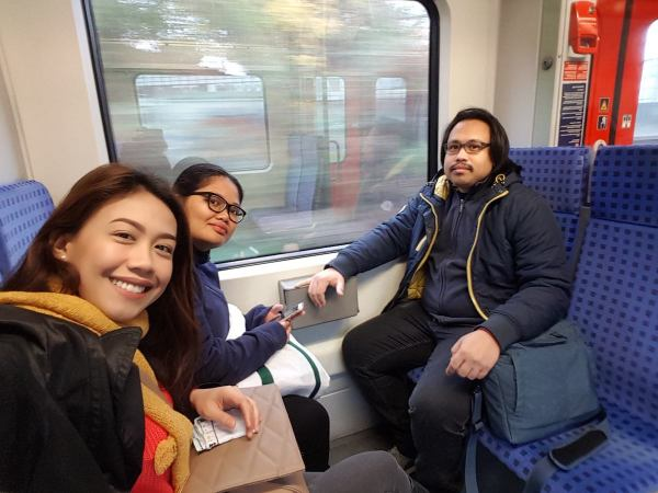 That's me, my sister-in-law, and my husband on a train to the city centre
